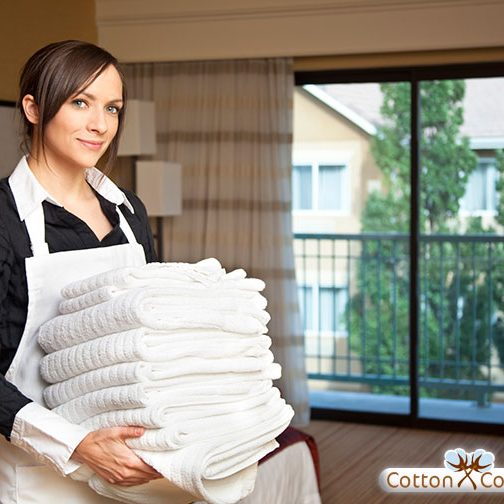 Hotel-maid-with-towels